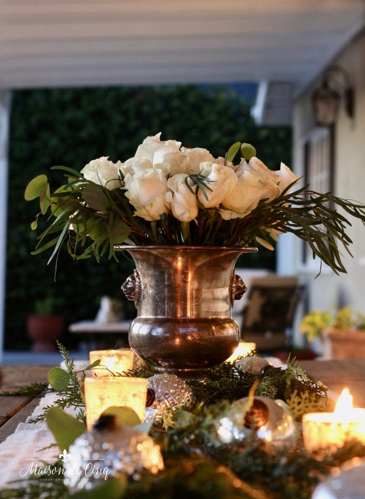 cozy Christmas patio with white roses in champagne bucket candles and silver ornaments