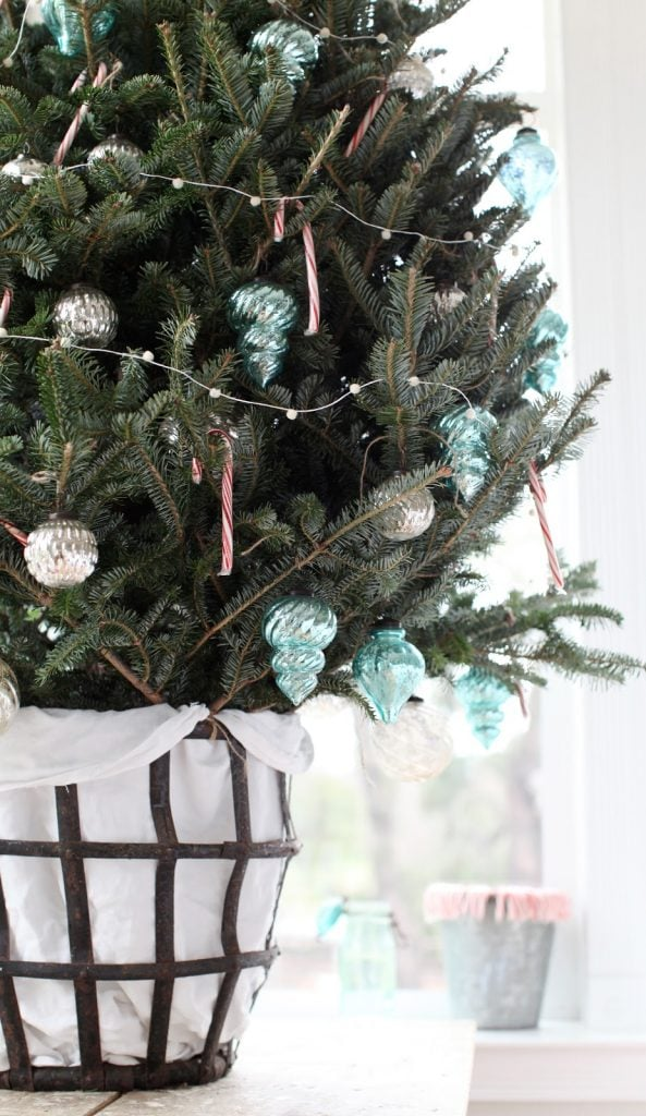 blue christmas decor ideas little tree in vintage basket with blue ornaments