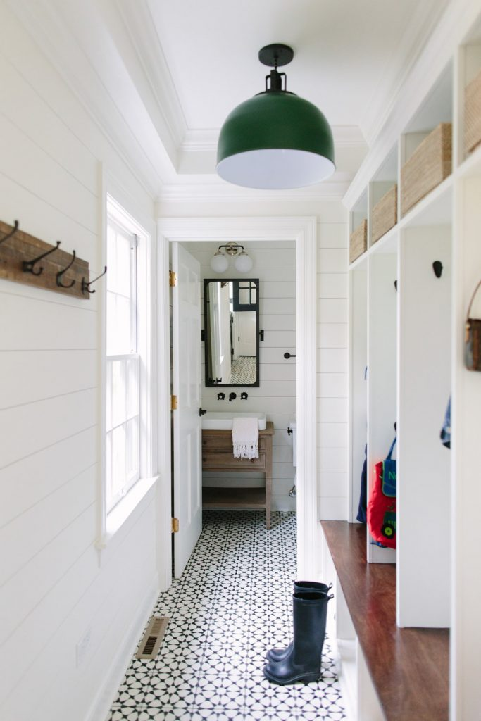cement floor in modern farmhouse mudroom