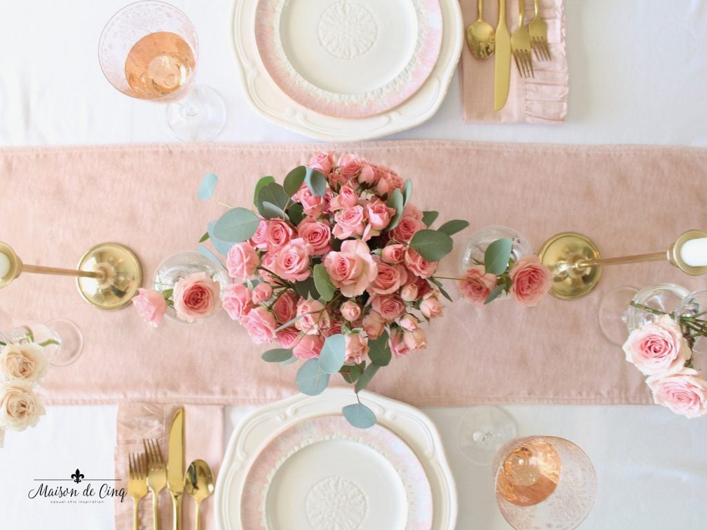 romantic Valentine's Day table for two gorgeous pink roses on pink velvet runner with gold flatware and brass candlesticks