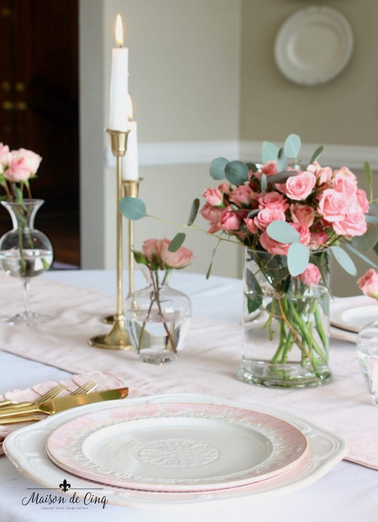 romantic Valentine's Day table brass candlesticks and pink and white plate