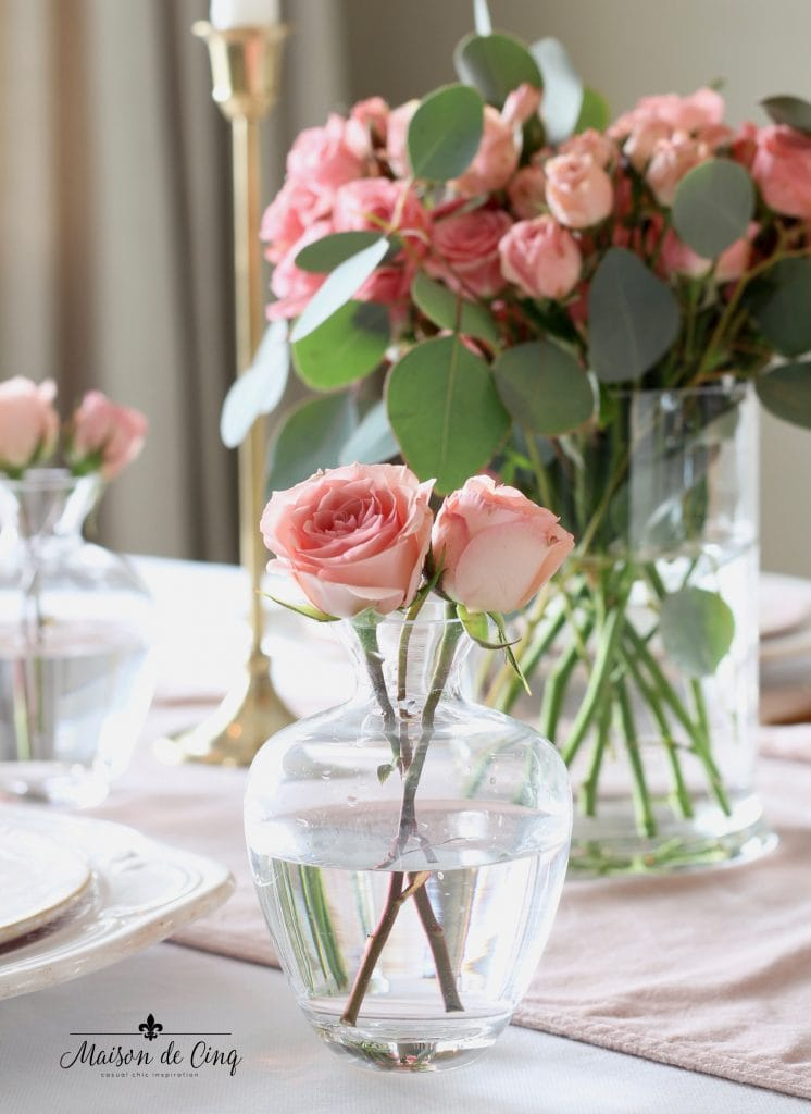 romantic Valentine's Day table pink roses in glass bud vase pretty tablescape