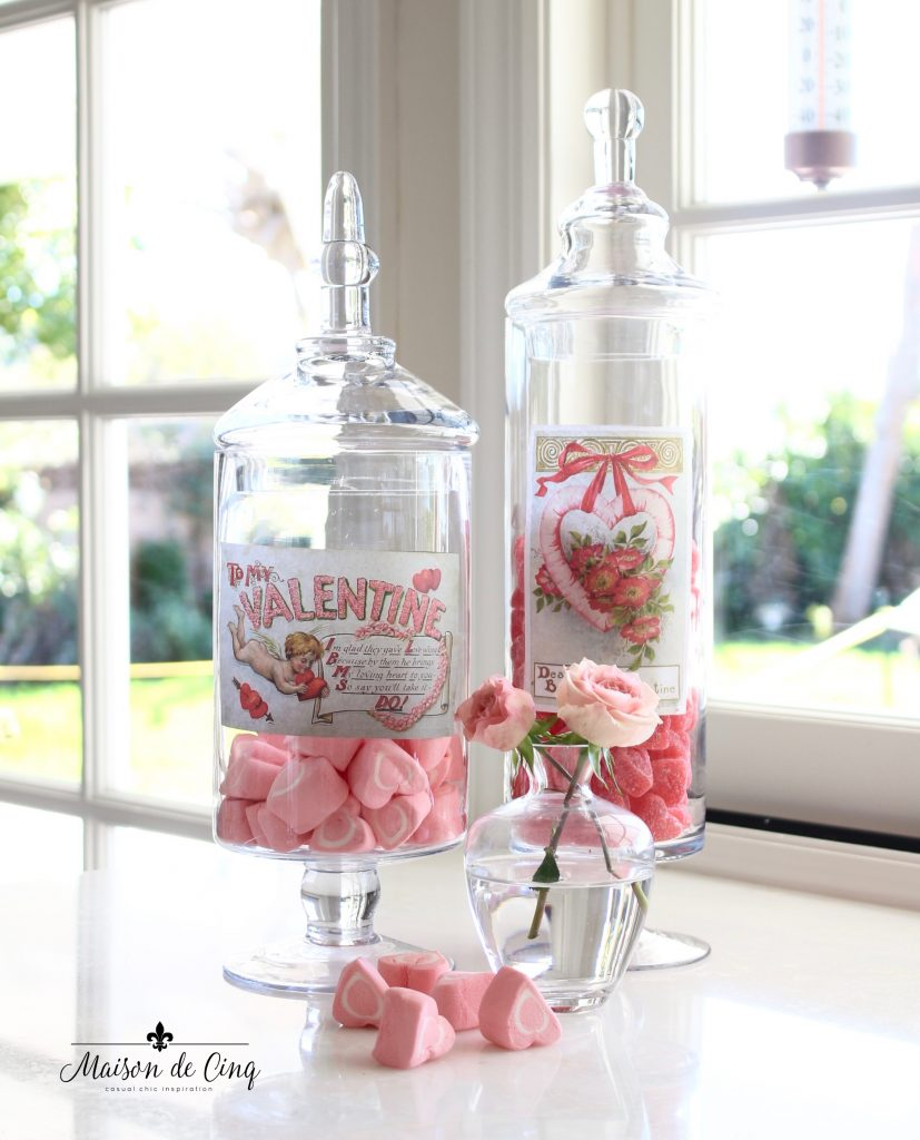 Valentine's Day decorating with vintage apothecary jars with pink candies