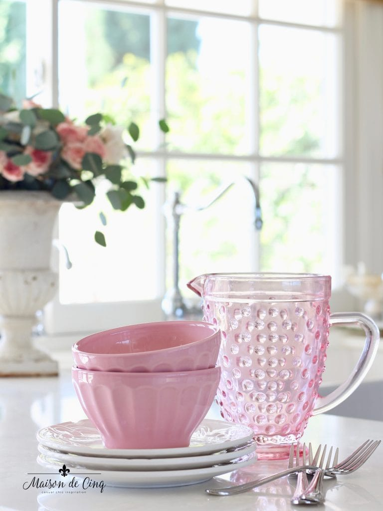 Valentine's Day decorating pink pitcher and bowls in white farmhouse kitchen