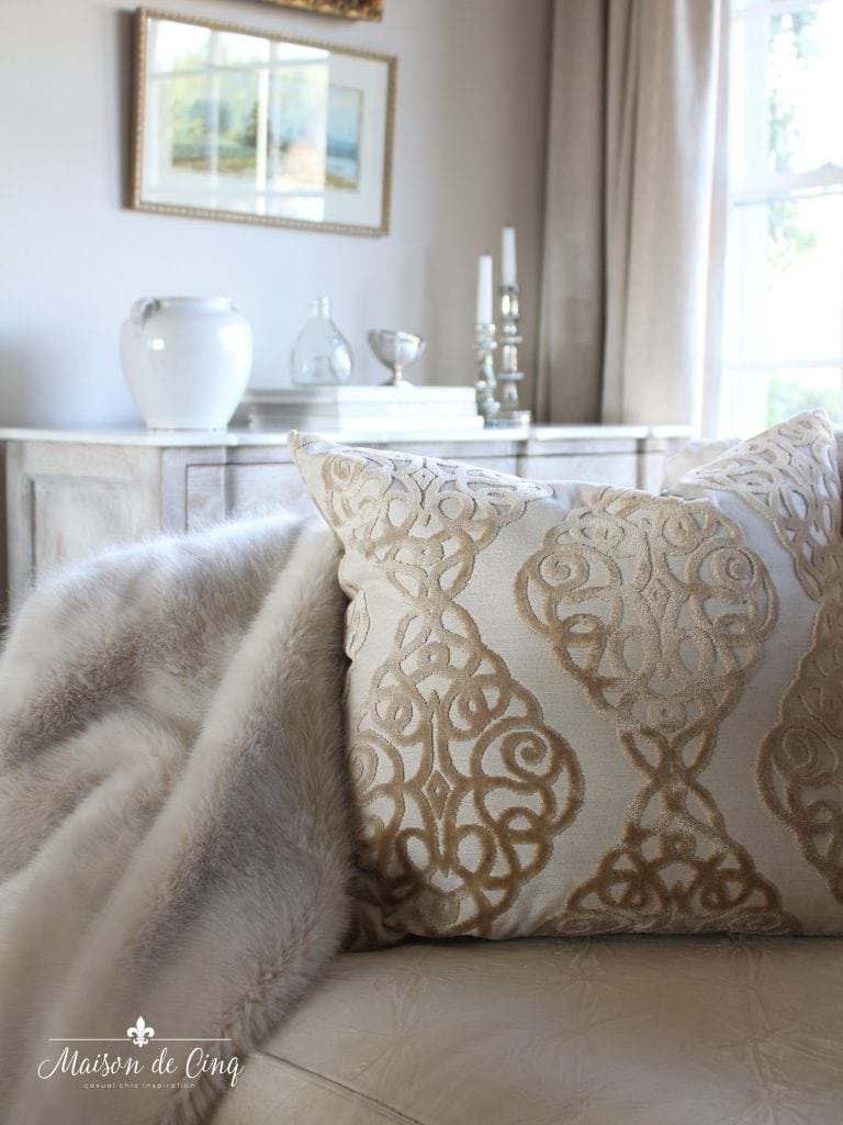 tips for winter decorating cozy winter throw and pretty pillow on sofa french country style room