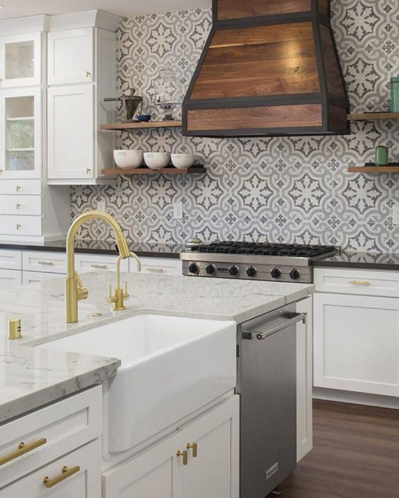 cement tile in white kitchen with custom wood hood