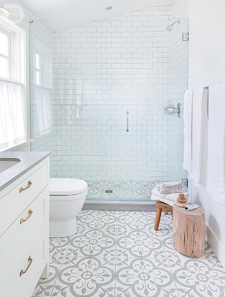 grey and white cement tile in bathroom with subway tile