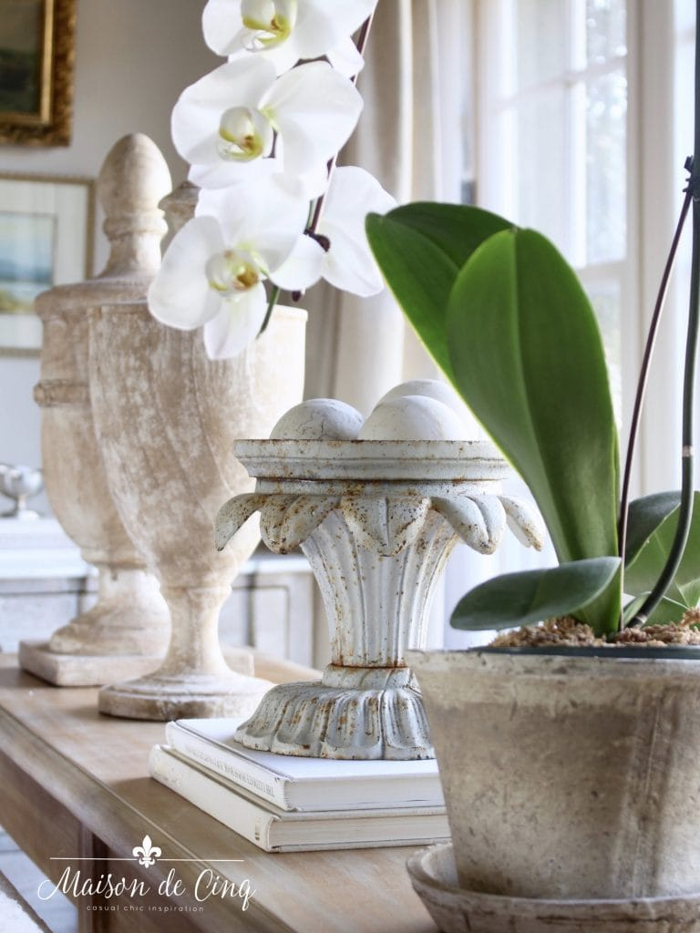 tips for winter decorating flowers plants urns on sofa table in gorgeous french country living room