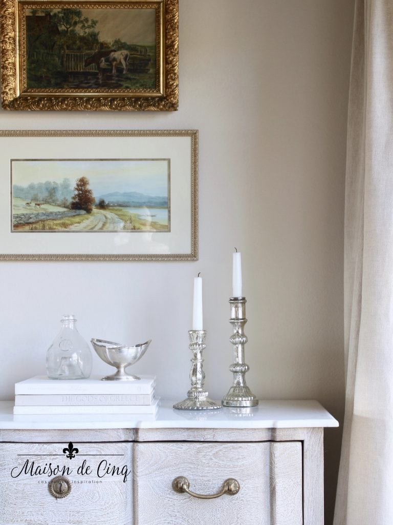 tips for winter decorating chest with silver candleholders and paintings above french country style living room