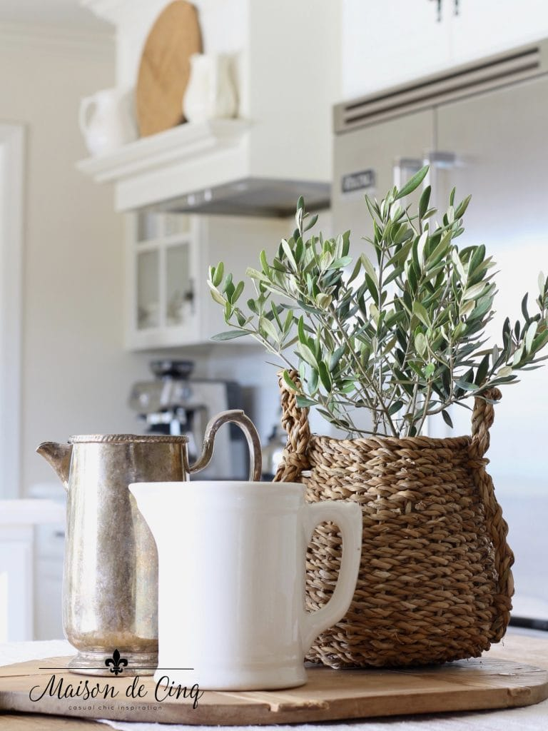 tips for winter decorating olive plant silver and ironstone pitchers in white farmhouse kitchen