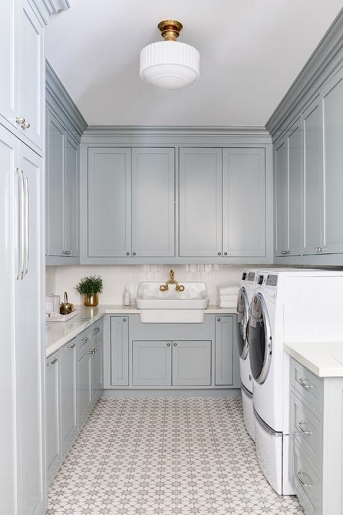 cement tile in gorgeous laundry room with gray cabinets