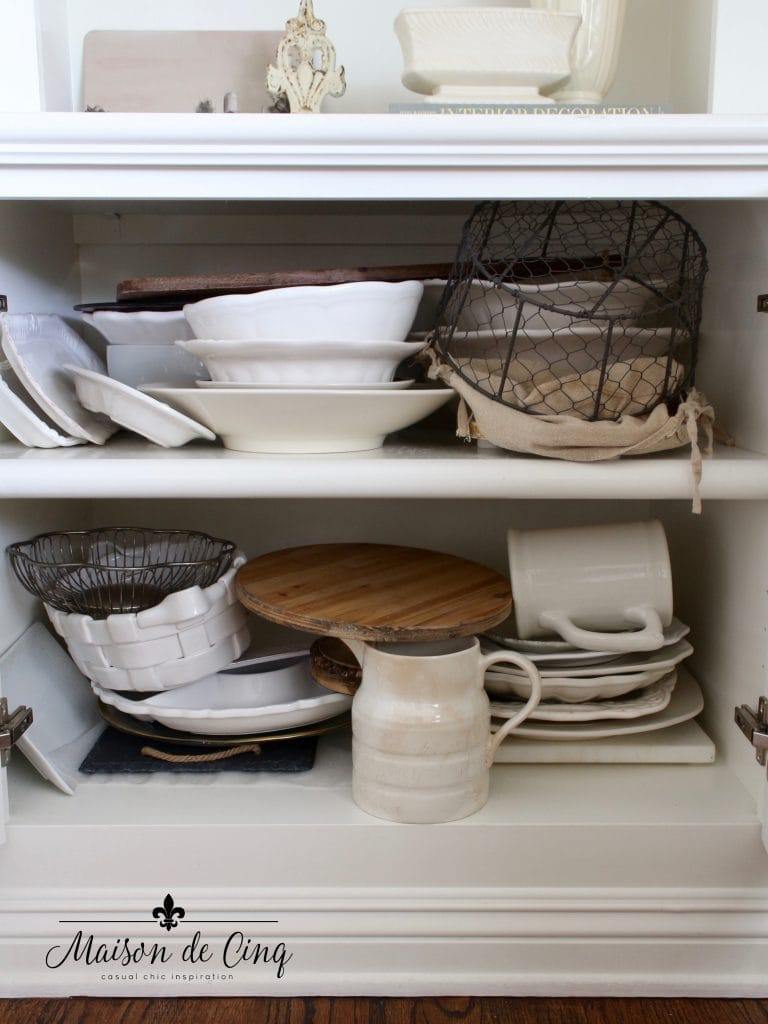 tips for organizing cabinets before shot of messy dishes and platters