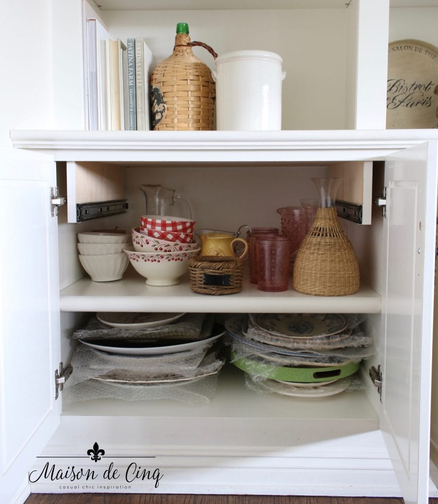 tips for organizing cabinets neat after shot platters and dishes