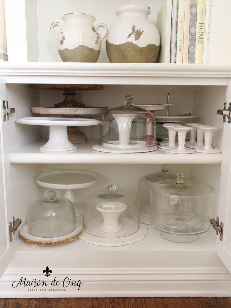 tips for organizing cabinets neat after shot of cake stands and cloches