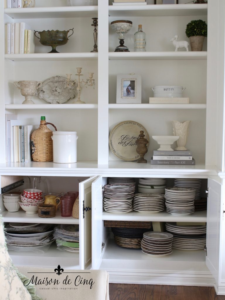 tips for organizing cabinets after shot of neater cabinets holding dishes and platters