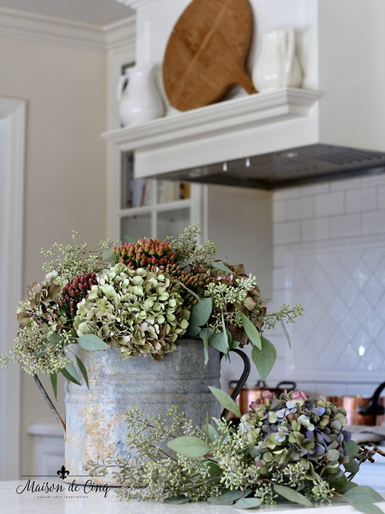 how to decorate with flowers hydrangeas in crusty vintage bucket white farmhouse kitchen