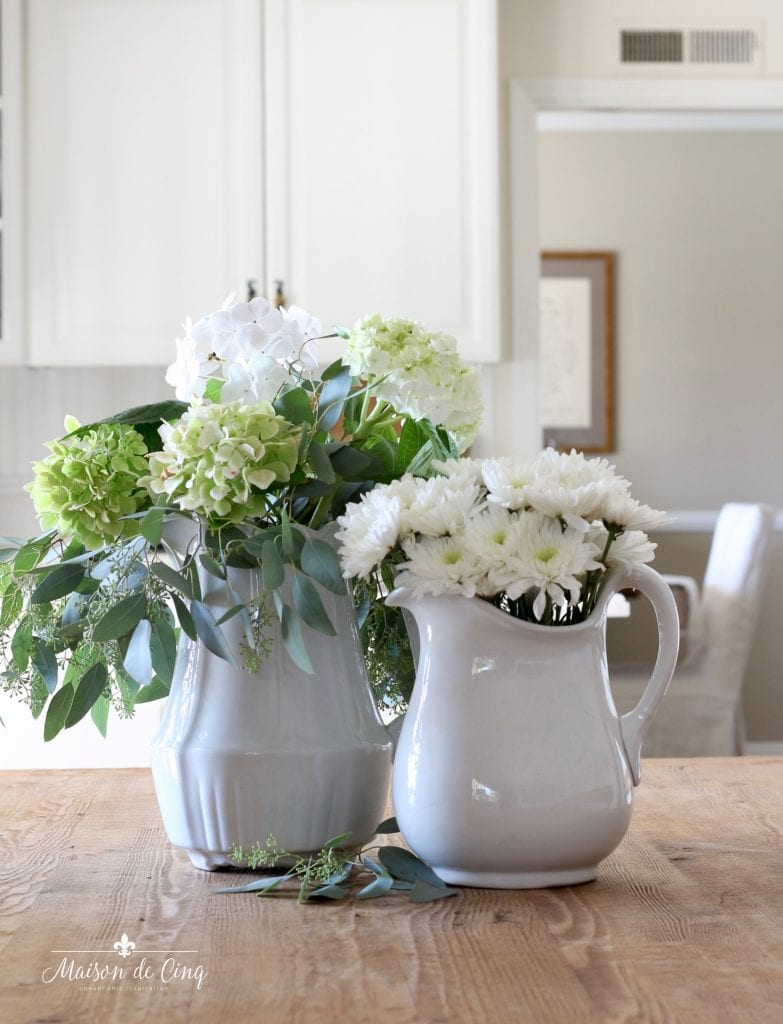 how to decorate with flowers white flowers in white ironstone pitchers