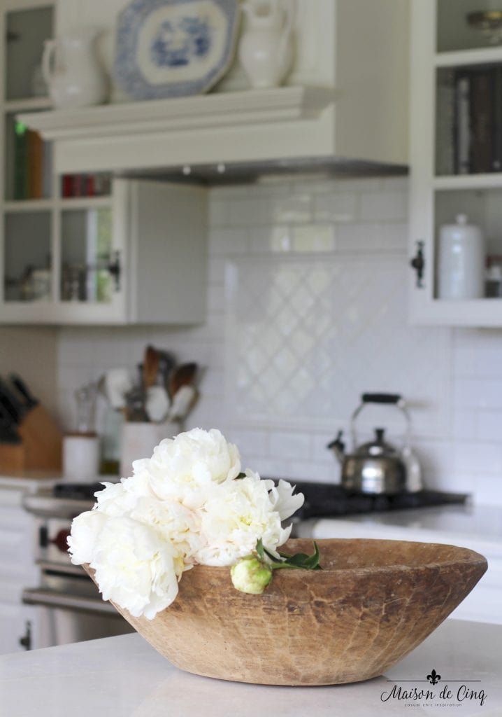 how to decorate with flowers peonies in antique dough bowl in white farmhouse kitchen