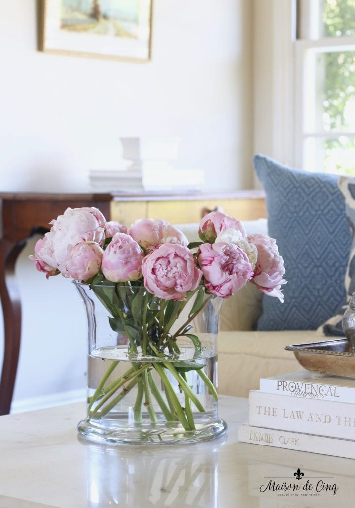 how to decorate with flowers pink peonies in glass vase pretty french country living room