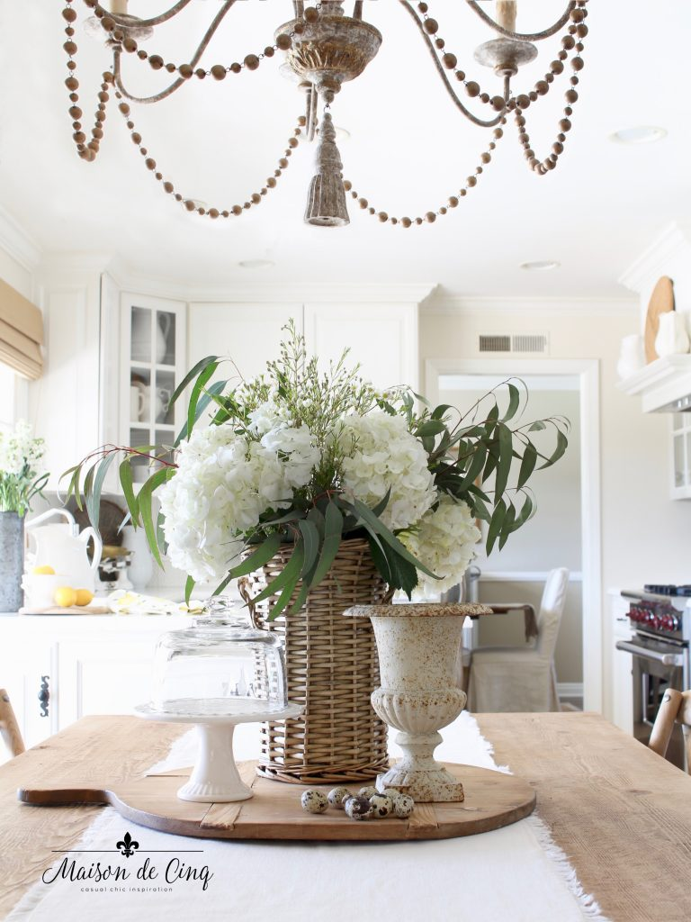 simple spring decorating ideas white flowers urn in white farmhouse kitchen