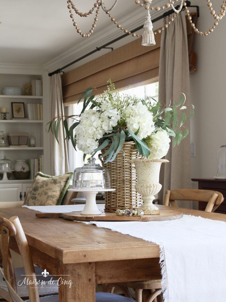 simple spring decorating white flowers on farmhouse table
