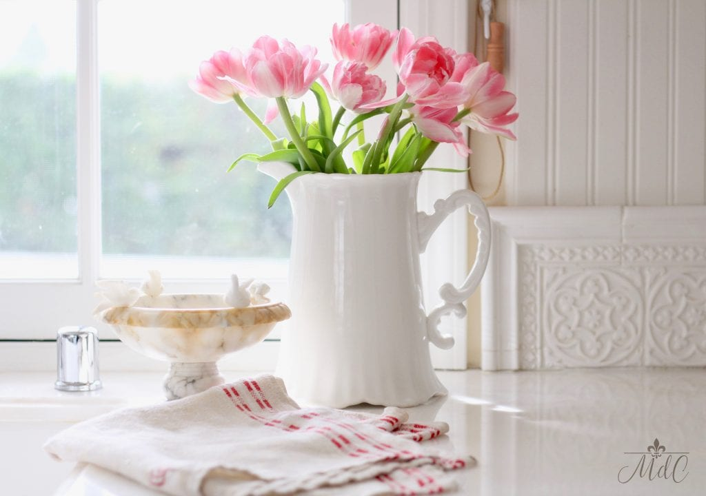 how to decorate with flowers pink tulips in white ironstone pitcher in white farmhouse kitchen