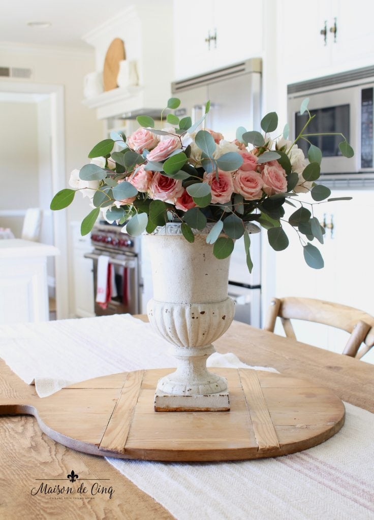how to decorate with flowers french urn with pink roses in white farmhouse kitchen