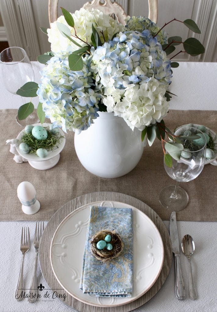 spring tablescape with blue and white hydrangeas burlap runner blue paisley napkins robins' eggs