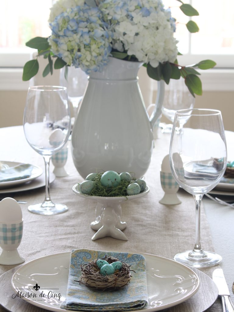 spring tablescape robins' egg blue eggs bunny cupcake stand and blue hydrangeas