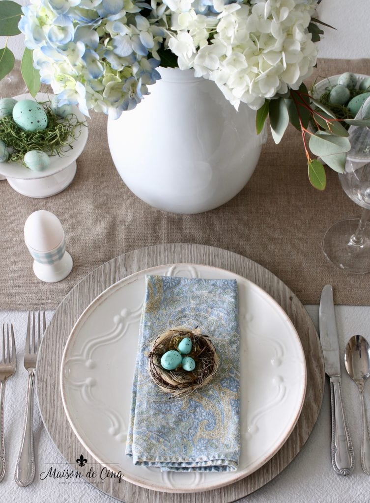 spring tablescape blue paisley napkin with nest and blue eggs