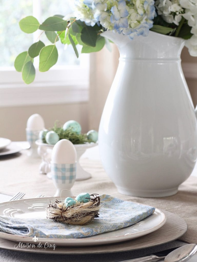 spring tablescape in shades of blue gingham egg cups blue eggs little nests