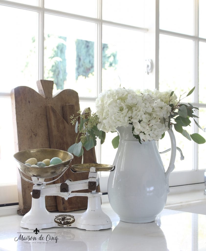 Easter decorating white hydrangeas cutting boards vintage scale