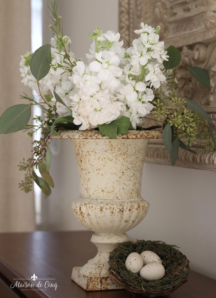 Easter decorating white flowers in vintage urn nest with eggs spring decor vignette french country