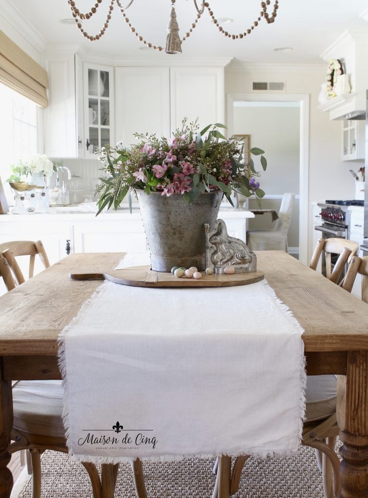 Easter decorating white french farmhouse kitchen flowers in bucket
