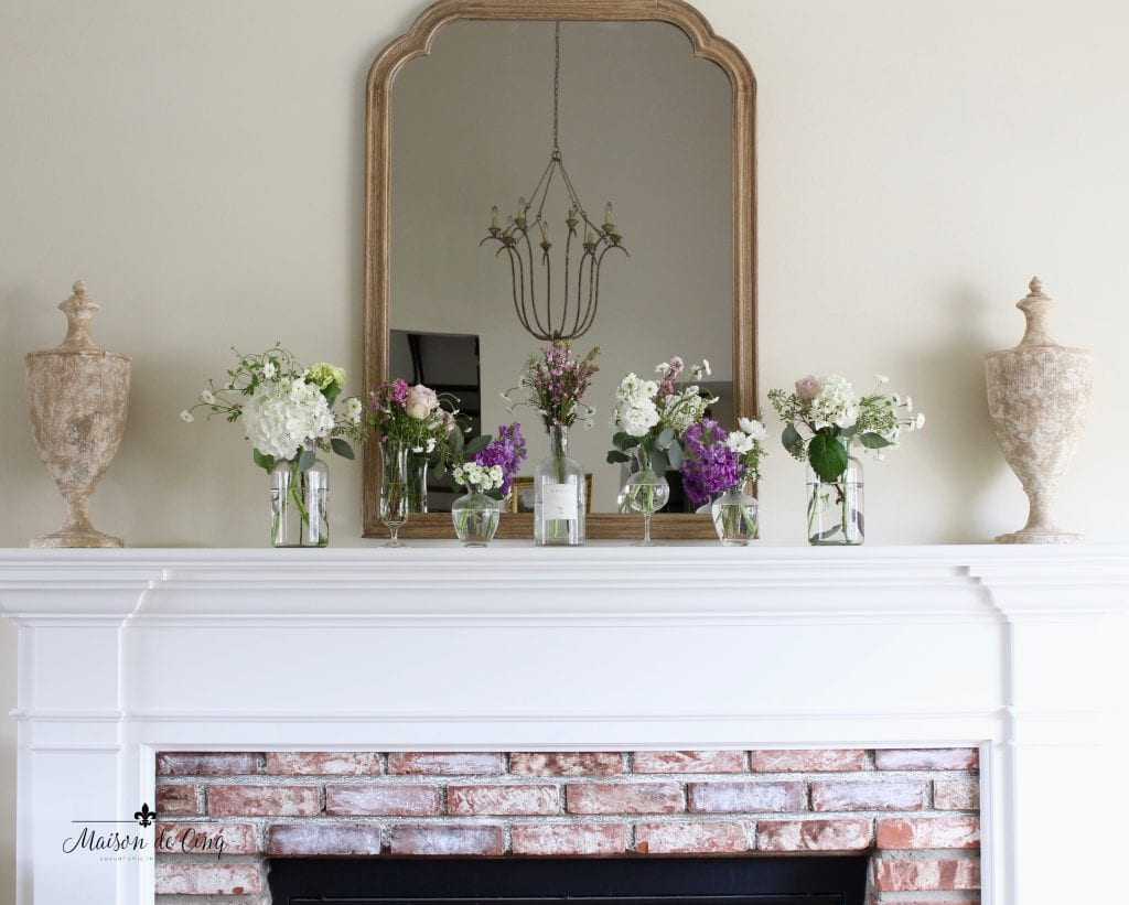 simple spring mantel fireplace french country style urns and flowers