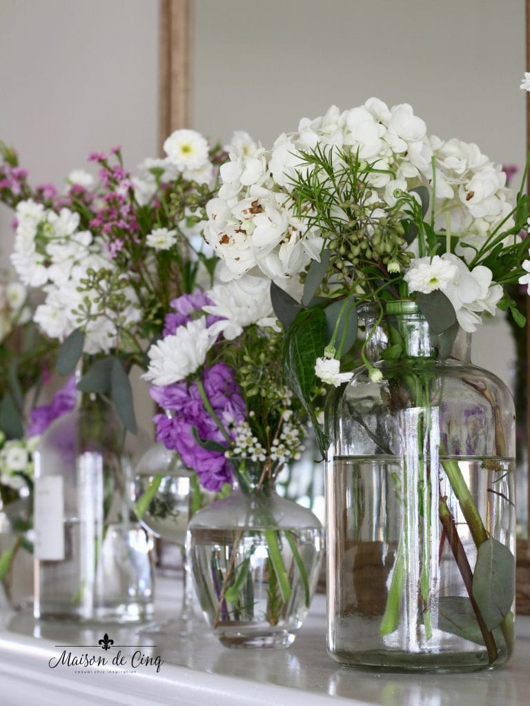simple spring flowers purple and white spring display decor