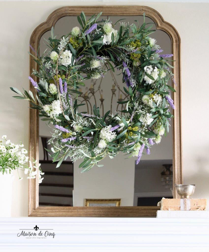 spring decorating gorgeous lavender wreath with white flowers and greenery on mirror