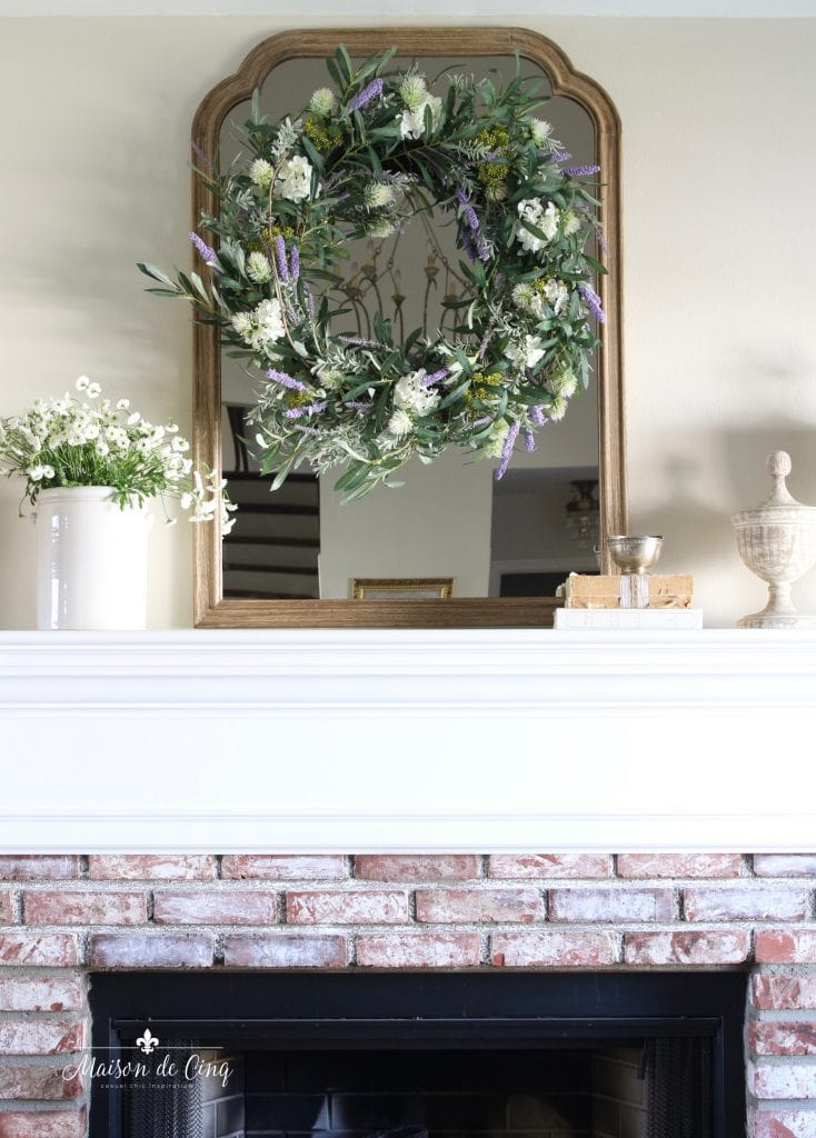 spring decorating with white flowers and wreath on french country mirror