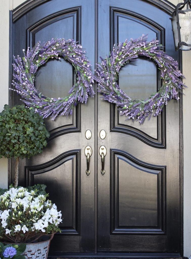spring decorating lavender wreaths on black doors gorgeous front porch decor