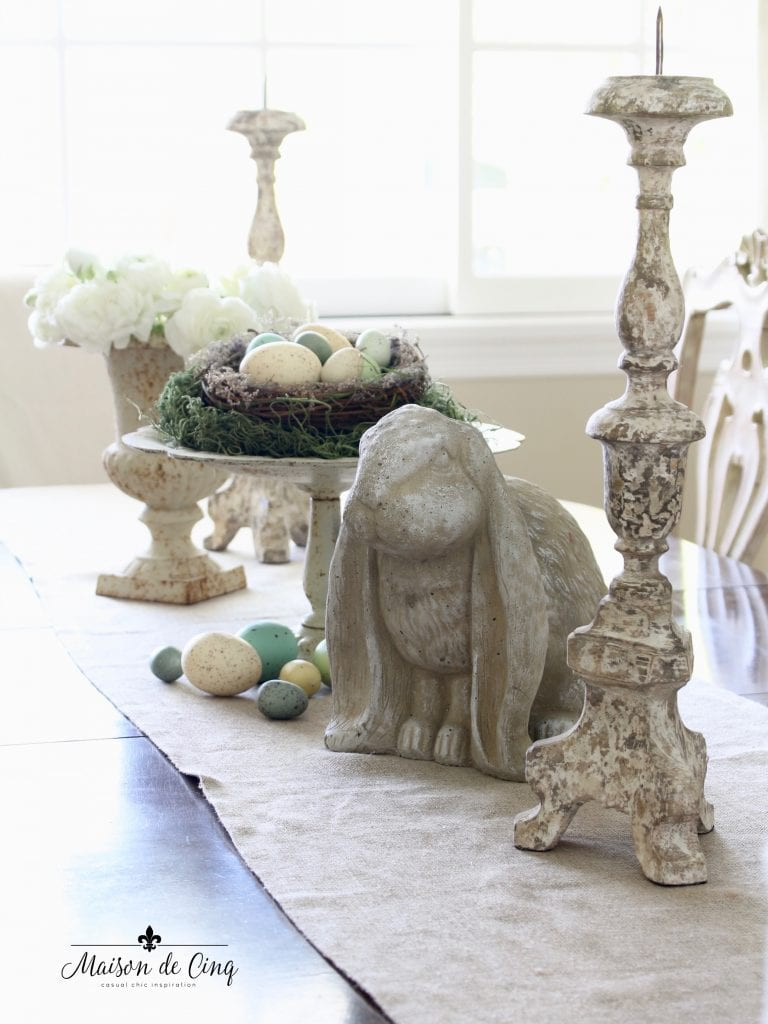 spring dining room decor tablescape with cement bunny and vintage elements