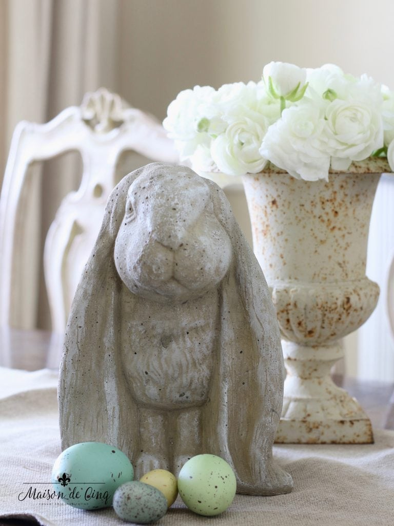vintage easter decor idea eggs cement bunny and white ranunculus flowers in vintage French urn