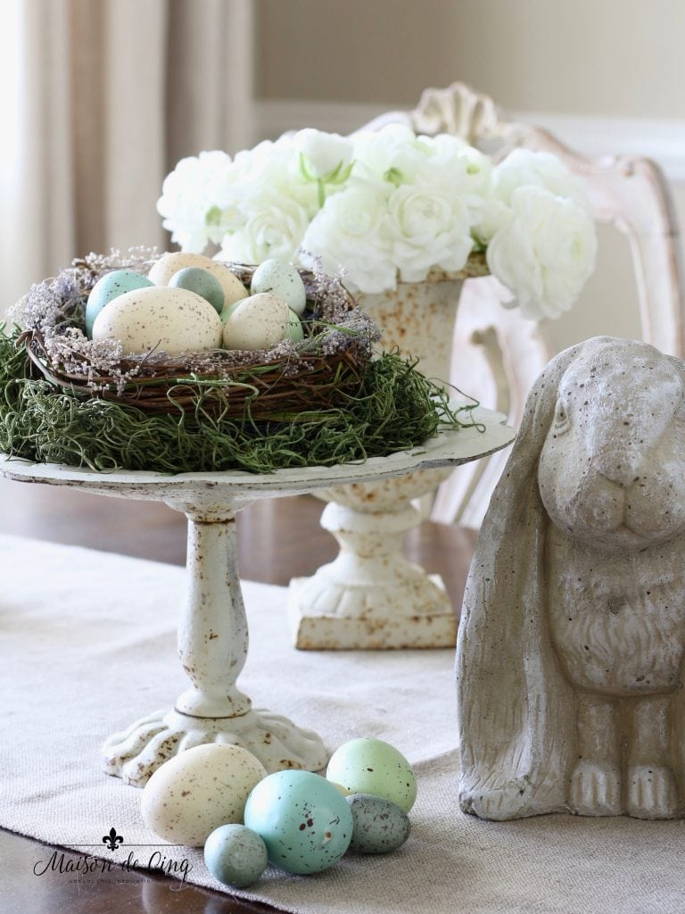 vintage spring decor bunny pedestal with eggs and nests white flowers