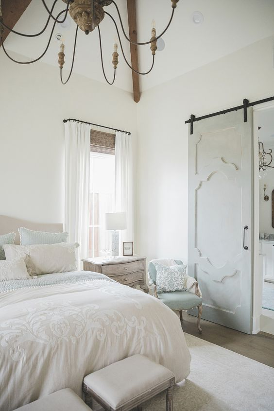 master bedroom makeover french farmhouse style room barn doors drapes blue chair