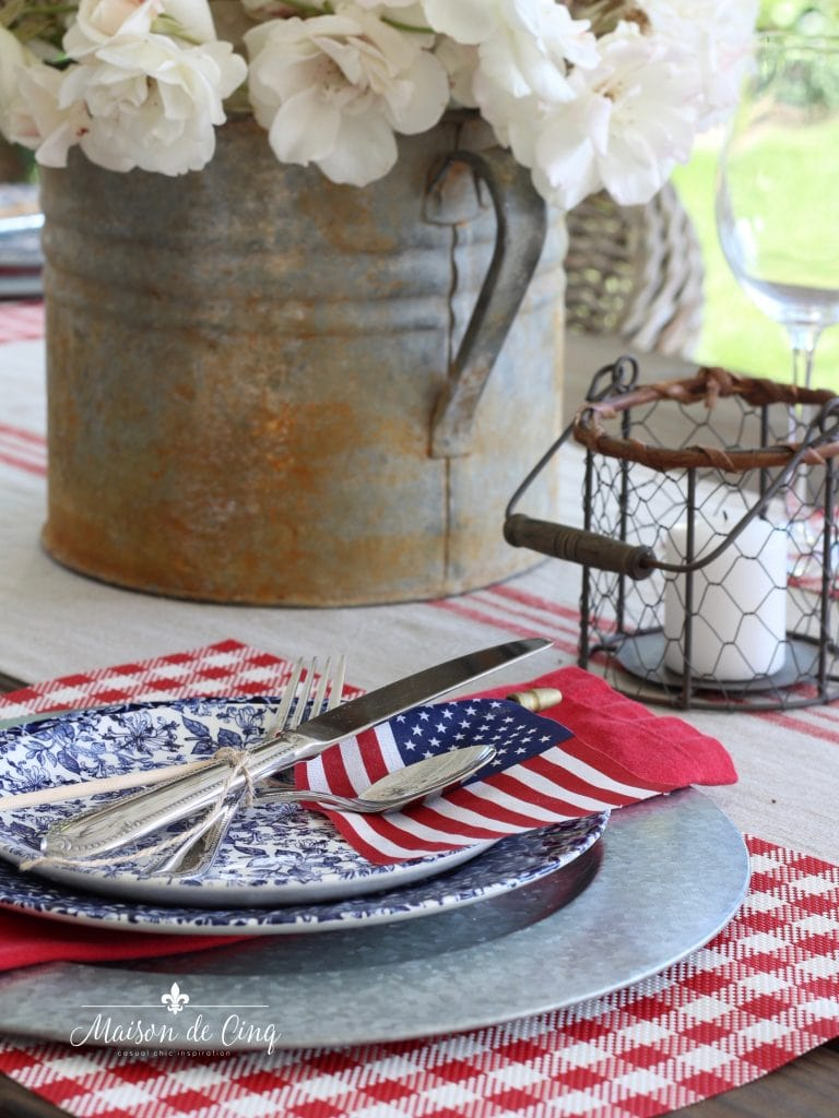 patriotic table setting american flag with red napkin on blue floral plate