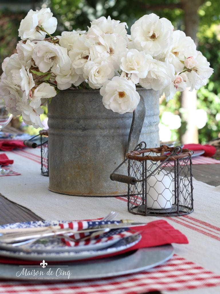 patriotic table setting with white roses in vintage zinc bucket fourth of july inspiration