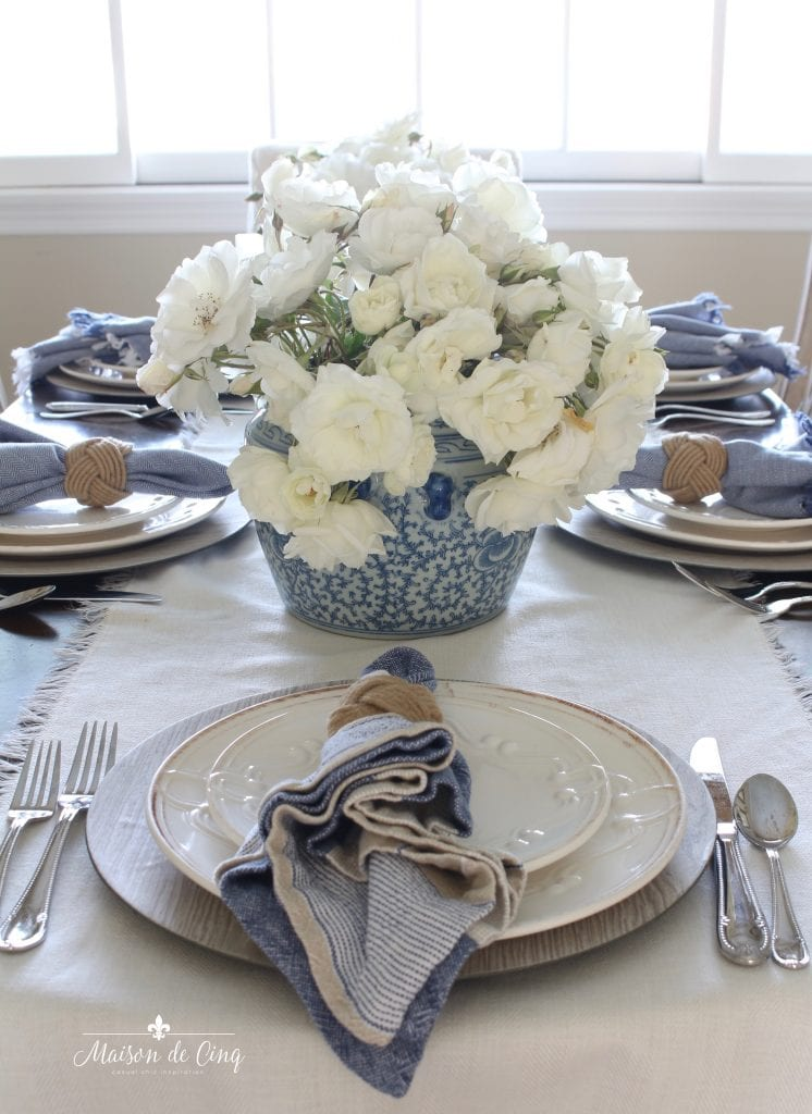 summer table setting blue and white ginger jar with white roses