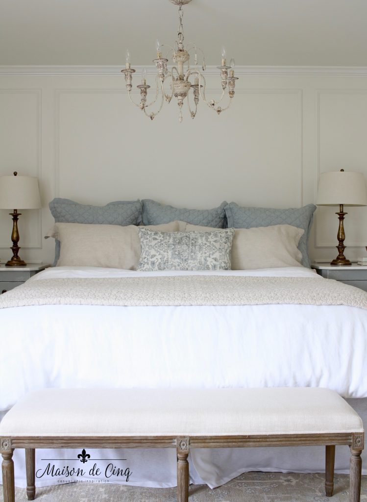 french farmhouse master bedroom makeover reveal gorgeous chandelier and bedding blue and white room