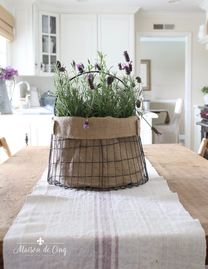 simple summer decorating with lavender in metal basket in gorgeous white kitchen