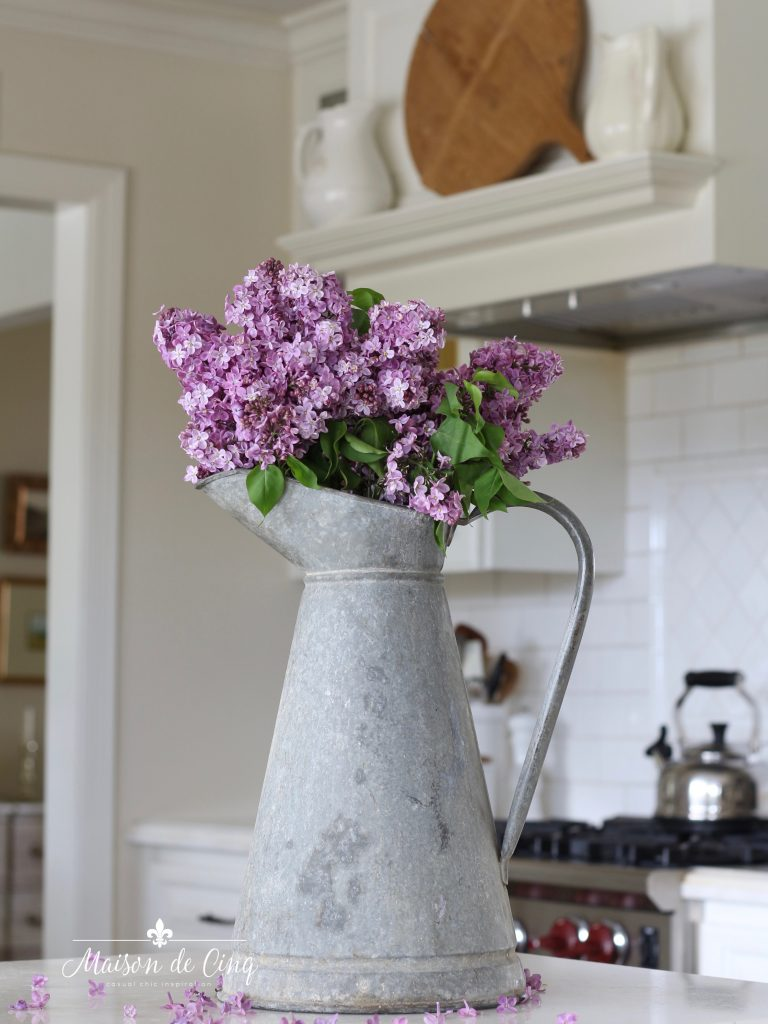 simple summer decorating lilacs in a vintage French zinc pitcher in white farmhouse kitchen