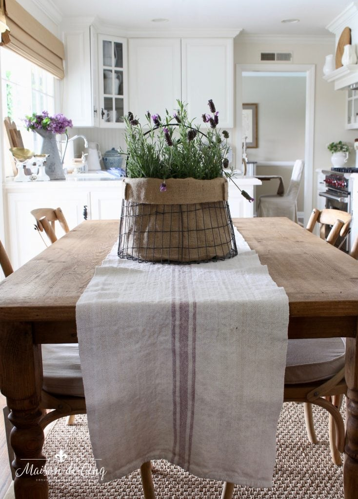 simple summer decorating farmhouse table with runner and lavender in metal basket